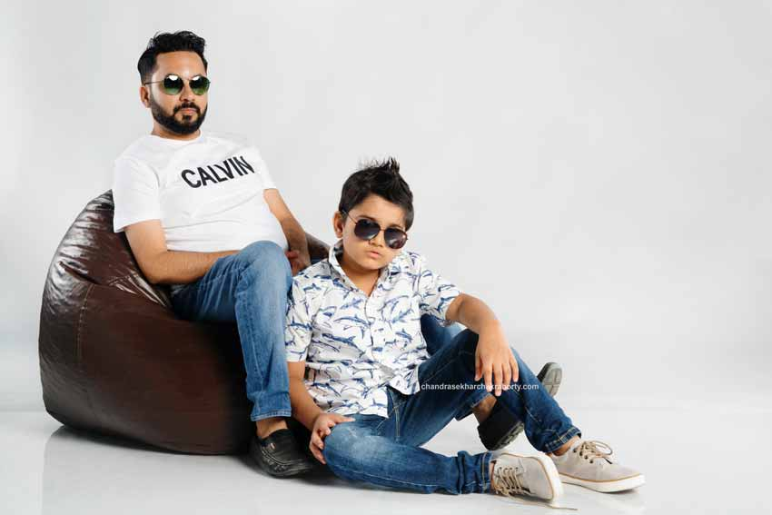 dad & son on studio backdroop for style family portrait