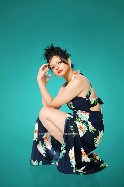 Fashion modeling with teal background