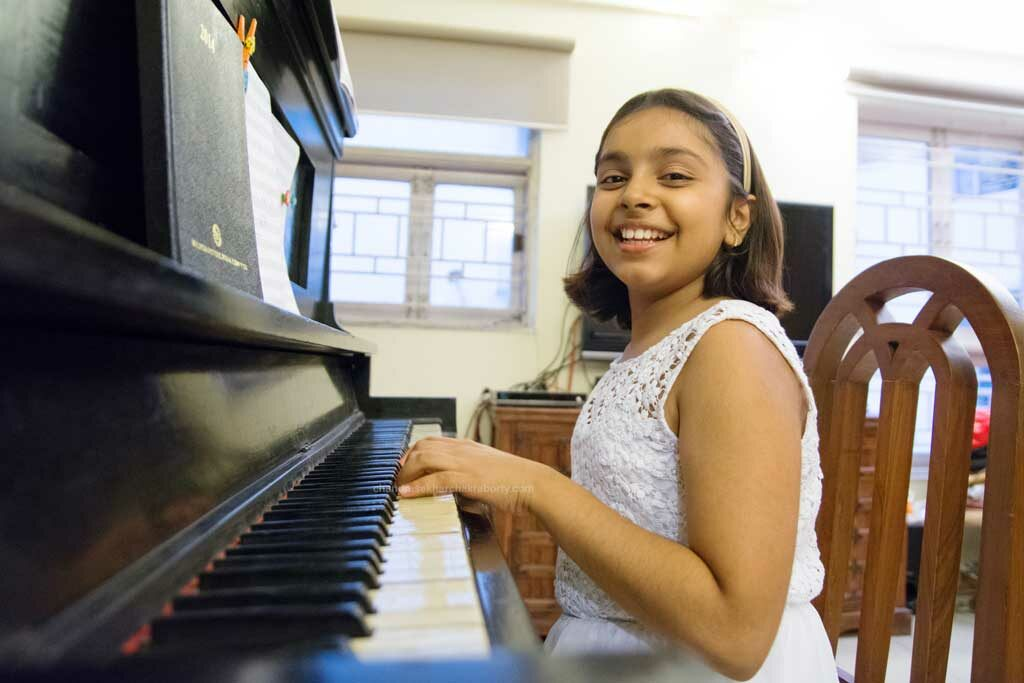 a girl playing piano on her birthday