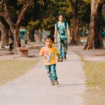 three years kid running in the park
