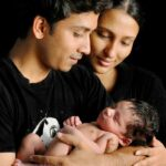 creative family portrait with new born baby