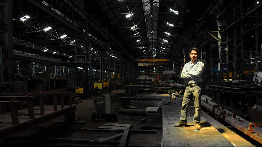 Industrial Photographer Chandrasekhar Chakraborty standing in Wagon Manufacturing Workshop