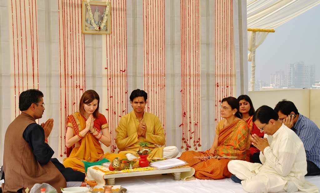 The day before wedding, the Italian bride & Indian groom are worshiping with family, morning Puja