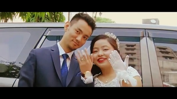 After Christian wedding, Northeast Indian groom & bride showing her marriage ring during video filming