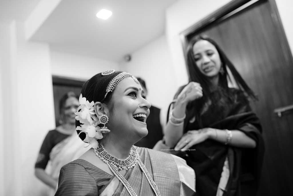 South Indian Bride's Black & white candid picture in makeup room