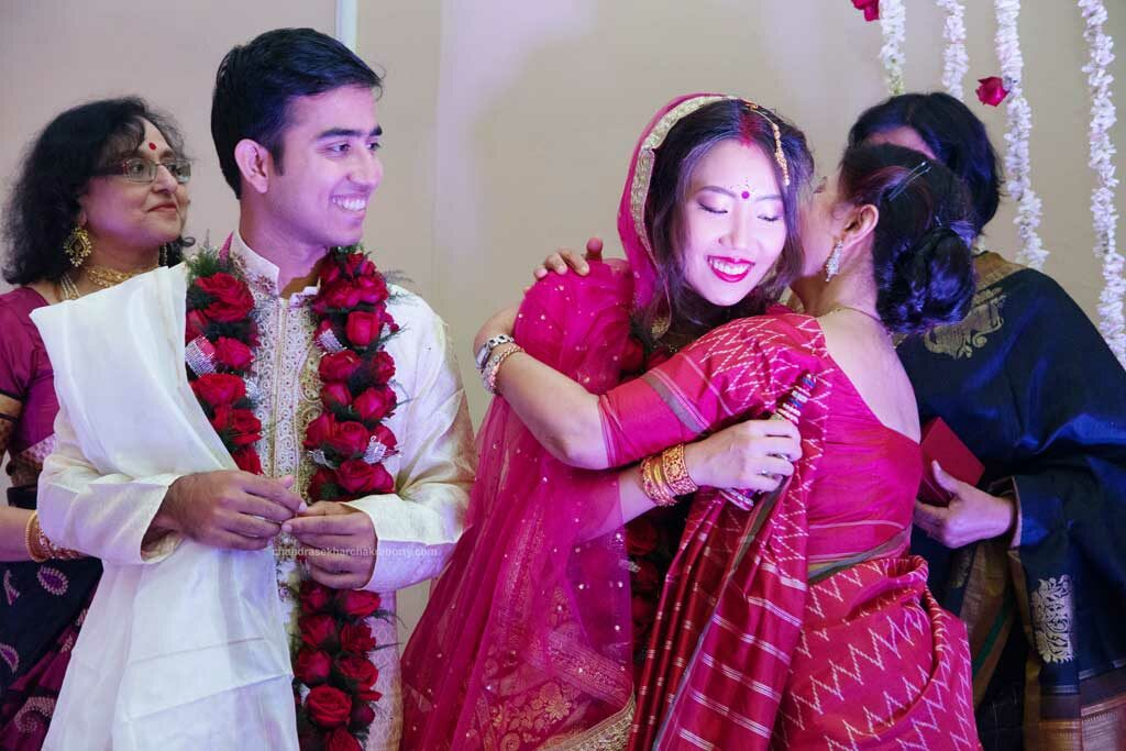 after the completion of bengali wedding, the mother-in-law welcomed the bride and hug her