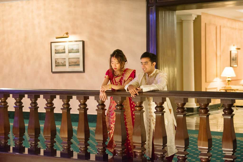the new couple standing in the balcony