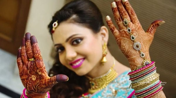 Indian bride showing Mehndi & ornaments for Cinematic Wedding video filming