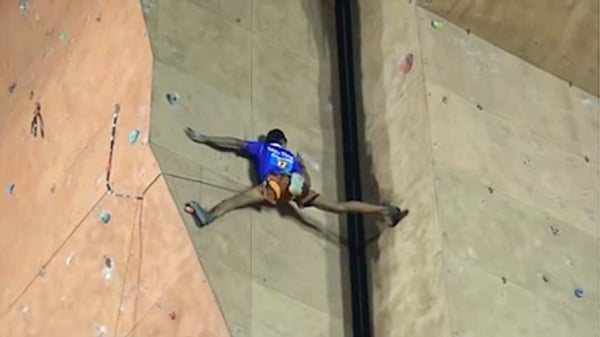 A climber Bridging pogition on open book wall during IMF National Sport Climbing Competition. Banner Image of video