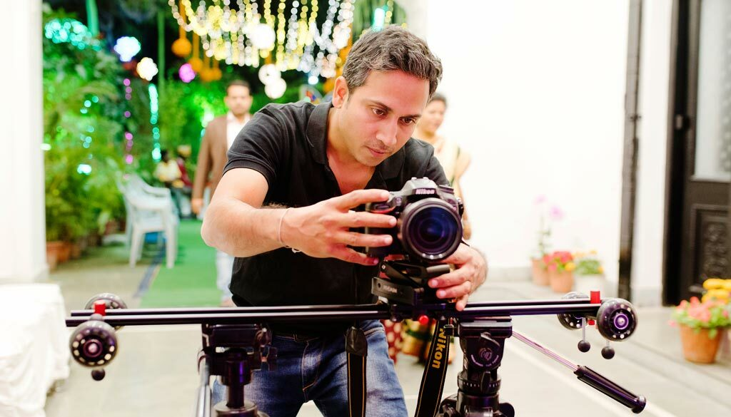 Best wedding photographer Chandrasekhar Chakraborty is filming Cinematic Wedding video with Nikon DSLR & slider