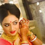 bengali bride getting ready for bridal photoshoot before wedding ceremony